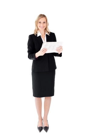 Delighted businesswoman holding a newspaper against white background photo