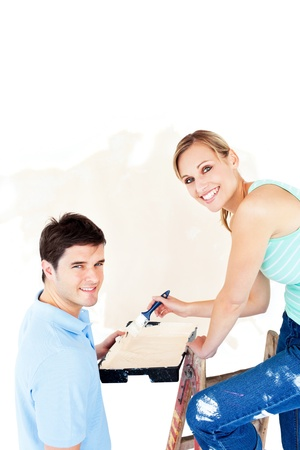 paintrush: Attractive caucasian couple painting a room Stock Photo