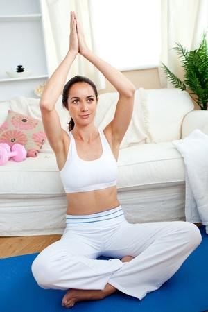 yoga pillows: Caucasian woman meditating in her living-room