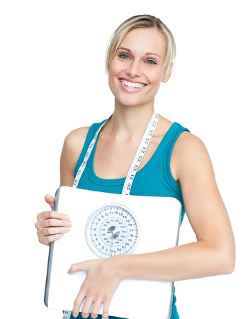 weight scale: Caucasian young woman holding a weight scale looking at the camera