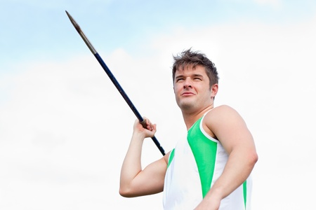 javelin: Handsome male throwing a javelin outdoors