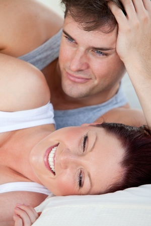 Portrait of a young pregnant woman and of her husband lying on the bed Stock Photo - 10164046