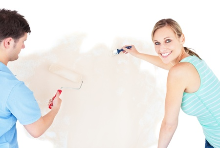 Smiling couple painting a room Stock Photo - 10137088