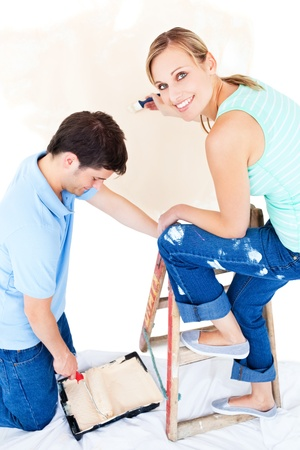Beautiful couple painting a room Stock Photo - 10170473