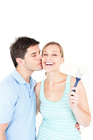 Loving couple painting a room Stock Photo - 10163733