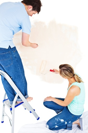 Concentrated couple painting a room Stock Photo - 10170471