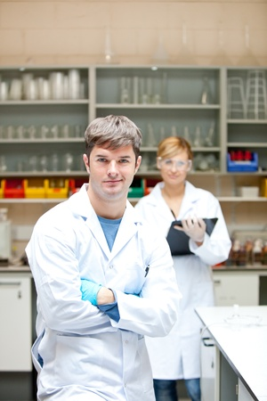 Two serious scientists looking at the camera standing Stock Photo - 10173371
