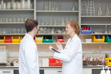 Serious scientists thinking Stock Photo - 10172450