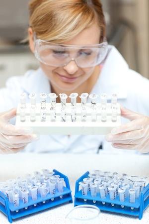 Caucasian female scientist holding samples Stock Photo - 10172311