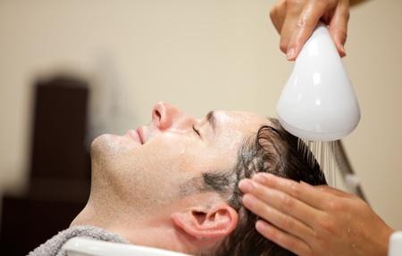 washing hair: Close-up of a young man having his hair washed