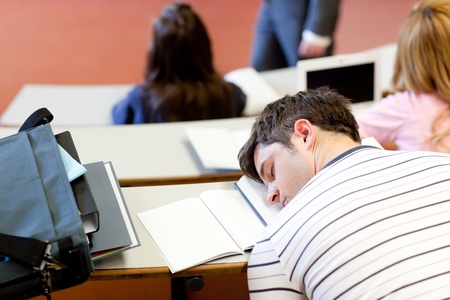 auditorium: Asleep male student during an university lesson Stock Photo