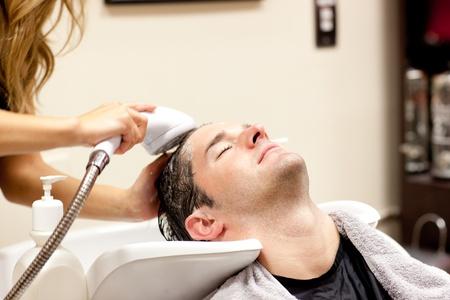 Cute man having a shampoo Stock Photo - 10171689