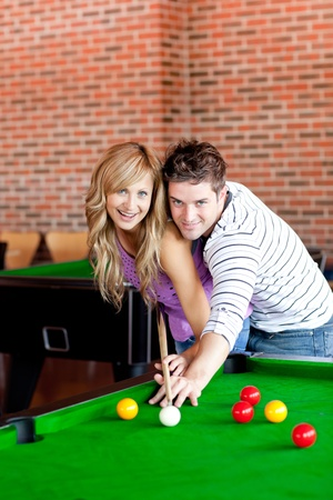 Young couple playing pool photo