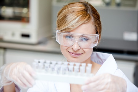 Portrait of a beautiful female scientist holding different samples Stock Photo - 10172374