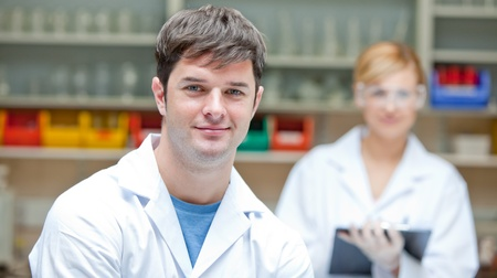 medical students: Two concentrated scientists looking at the camera