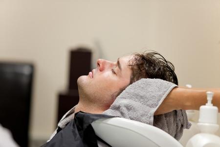 Handsome caucasian man shampooed photo