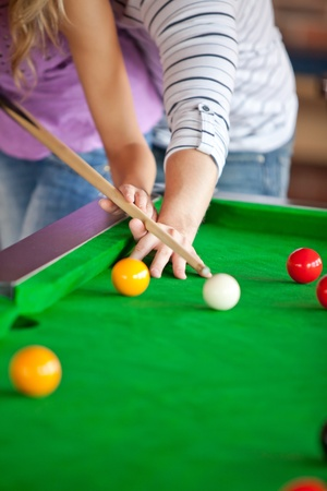 Attentive Boyfriend Learning His Girlfriend How To Play Pool Stock - How to play pool table