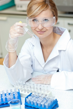 Self-assured caucasian female scientist holding samples Stock Photo - 10170845