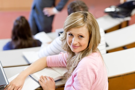 Portrait of a smiling female student during a university lesson Stock Photo