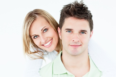 laughing couple: Portrait of a young happy couple standing against a white background Stock Photo