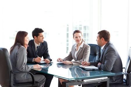 Businessmen and businesswomen talking during a meeting photo