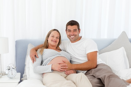 seven persons: Attentive man touching the belly of his wife