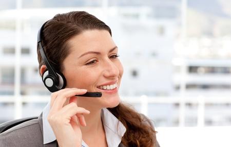 earpiece: Pretty businesswoman with earpiece