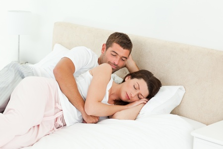 peacefully: Passionate man looking at his girlfriend sleeping peacefully  Stock Photo
