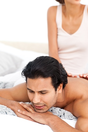 Close up of a woman doing a massage to her boyfriend photo
