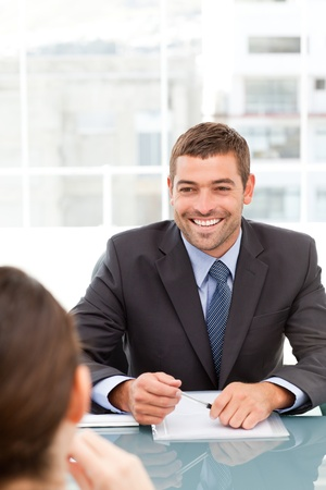 Cheerful businessman during a meeting with a collegue photo