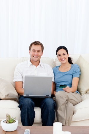 Portrait of a happy couple buying online with their credit card Stock Photo - 10174523