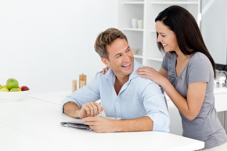 Happy couple doing a cryptic crossword together Stock Photo - 10175559