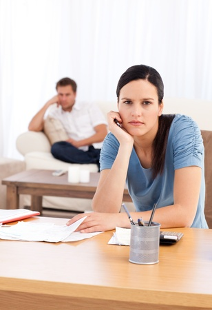 Couple sulking after doing their account together Stock Photo - 10171094