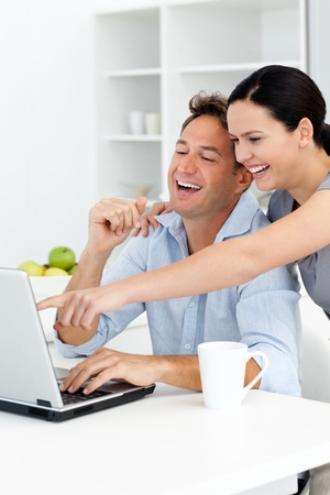 Happy woman showing something on the laptop to his boyfriend photo