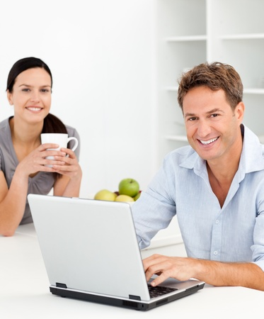 Portrait of a couple relaxing together in the kitchen photo