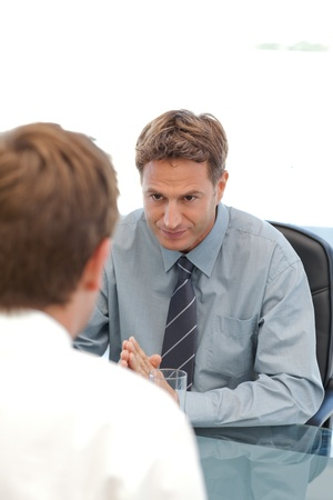 head start: Charismatic manager during an interview with an employee