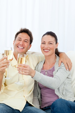 Happy couple celebrating with flute of champagne Stock Photo - 10173220