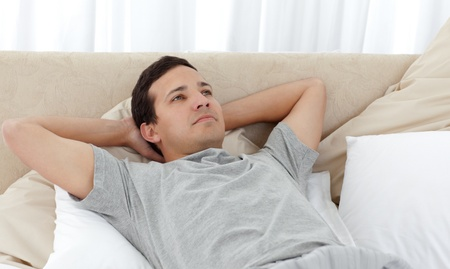 unbend: Quiet man relaxing on his bed Stock Photo