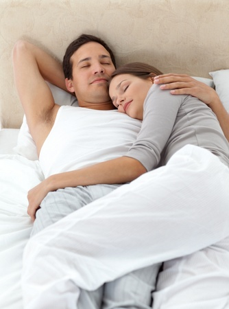 Cute couple sleeping in each other
