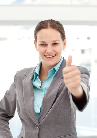 affirmation: Happy businesswoman doing a thumbs up