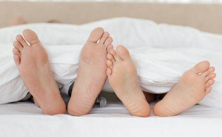 bed feet: Close up of couple