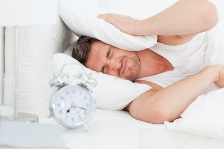 A irritate man in his bed before waking up  Stock Photo - 10163803