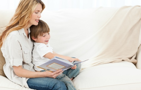 kids reading book: Mother reading with her son
