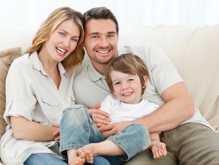 Happy family on their sofa photo