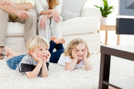 funny movies: Adorable family watching tv Stock Photo