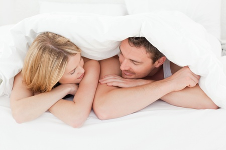 couple embracing: Lovely couple in their bed