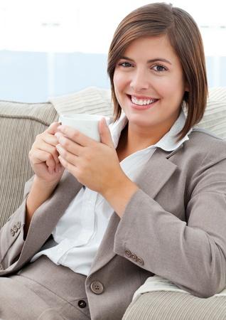 Businesswoman drinking coffee Stock Photo - 10174519