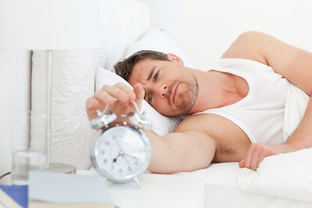 An unhappy man in his bed before waking up Stock Photo - 10163994