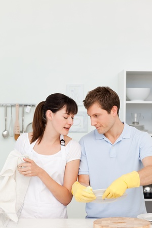 Lovers washing dishes together photo