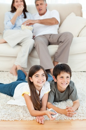 Family watching tv in the living room Stock fotó